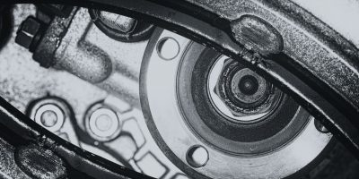 Unusual robotic eye in steampunk style in grayscale. Focused robot look. Monochrome background pattern close-up.